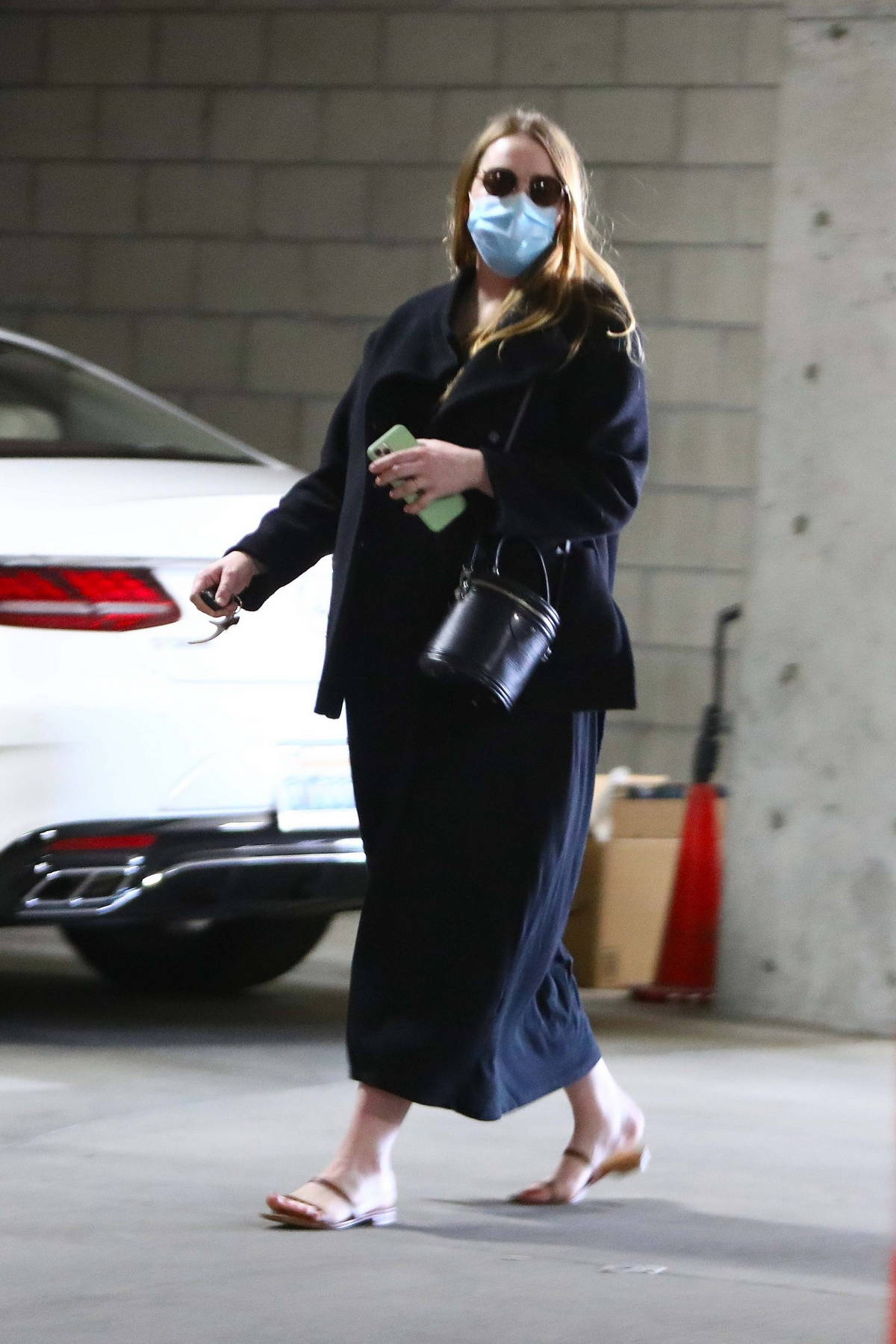 Emma Stone returns to the parking garage valet for her car after running errands in Santa Monica, California