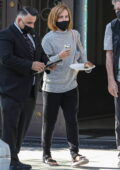 Emma Watson shows off her new haircut while visiting a tailor in Beverly Hills, California