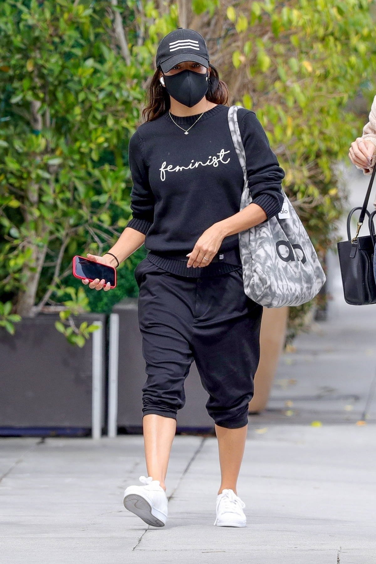 Eva Longoria wears a 'Feminist' sweater on International Women's Day while shopping at Alo Yoga store in Beverly Hills, California