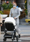 Gigi Hadid looks cozy in a grey knit outfit as she steps out for lunch with a friend and her baby Khai in New York City