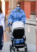 Gigi Hadid steps out wearing a blue trench coat as she enjoys a stroll with her daughter Khai in New York City