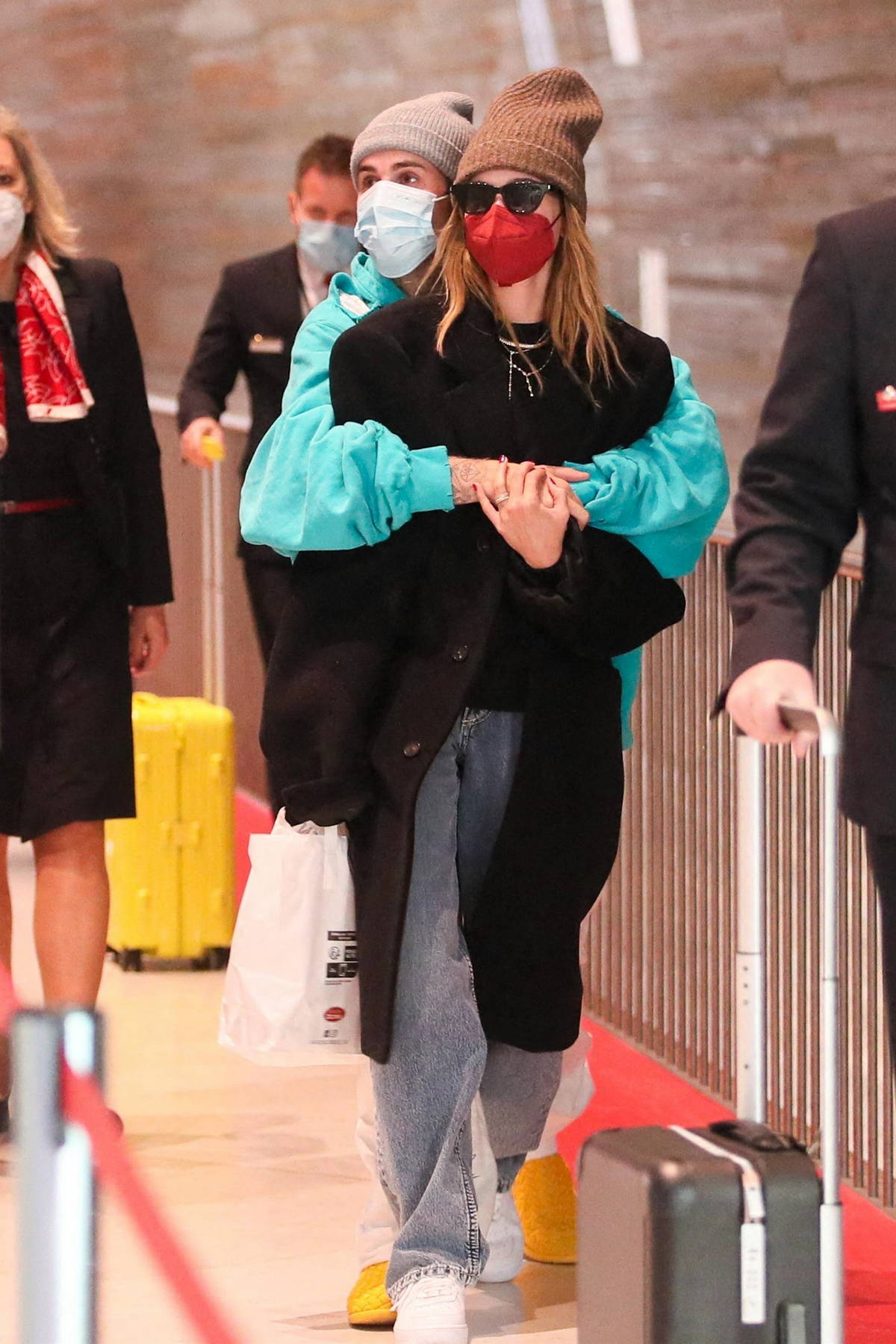 Hailey Bieber and Justin Bieber pack on some PDA as they arrive for a flight out of Charles de Gaulle airport in Paris, France