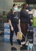 Hailey Bieber sports all-black athleisure while making a juice run with her cute little pup in Los Angeles