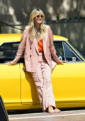 Heidi Klum poses in a pinstriped pink suit outside of America's Got Talent in Pasadena, California