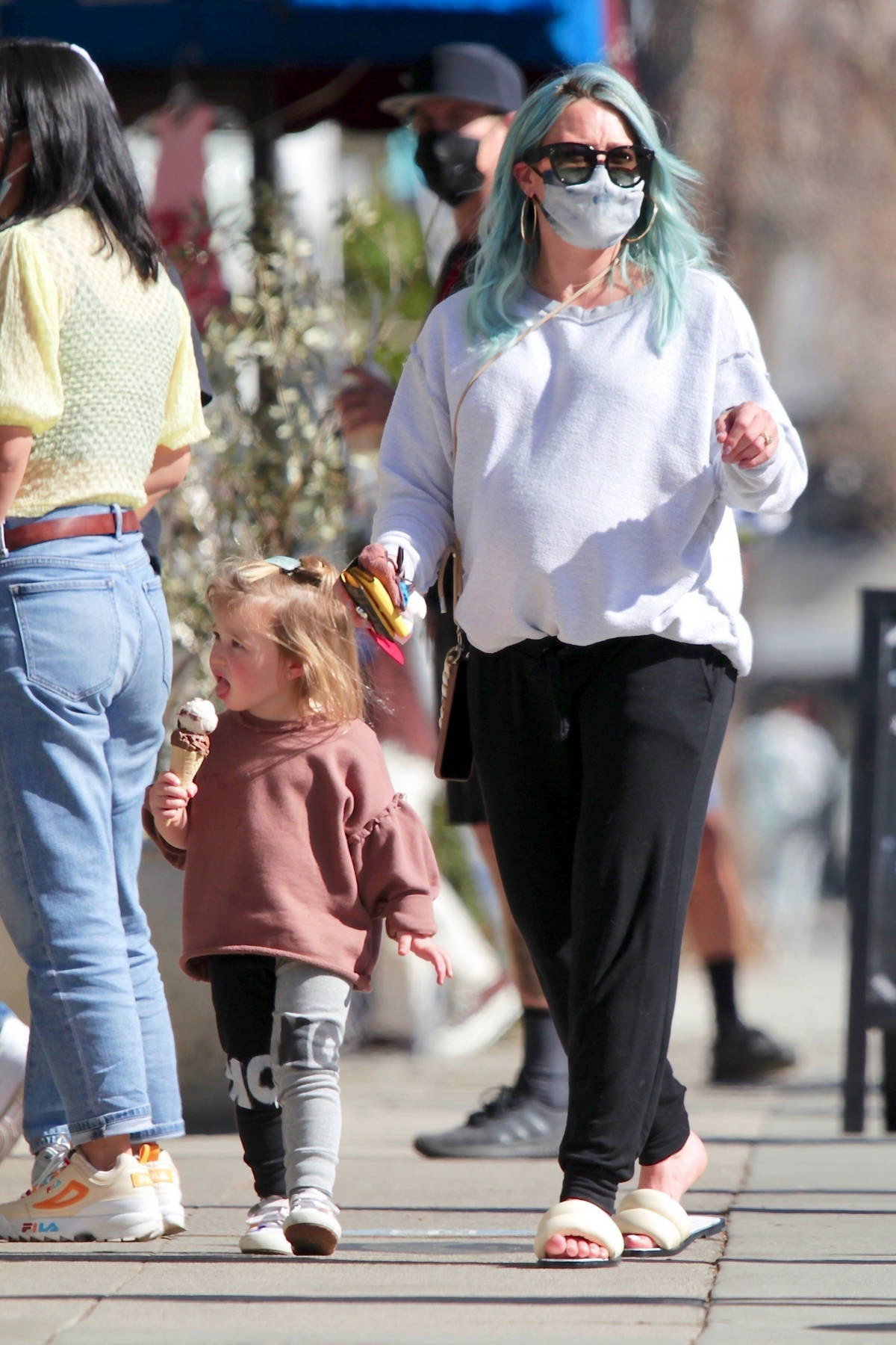Hilary Duff treats her daughter with an ice cream while out for coffee in Los Angeles