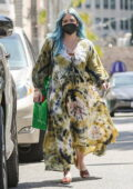 Hilary Duff wears a flowy green tie-dye dress while out shopping at Bottega Veneta in Beverly Hills, California