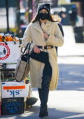 Irina Shayk looks stylish in cream Max Mara coat while out on a coffee run in New York City