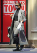 Irina Shayk looks super stylish in a plaid overcoat and knee-high boots while stepping out in New York City