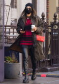 Irina Shayk rocks a brown jacket with leather pants and a beanie while during a coffee run in New York City