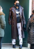 Irina Shayk rocks a long leather jacket with a hoodie while taking a stroll with her daughter in New York City