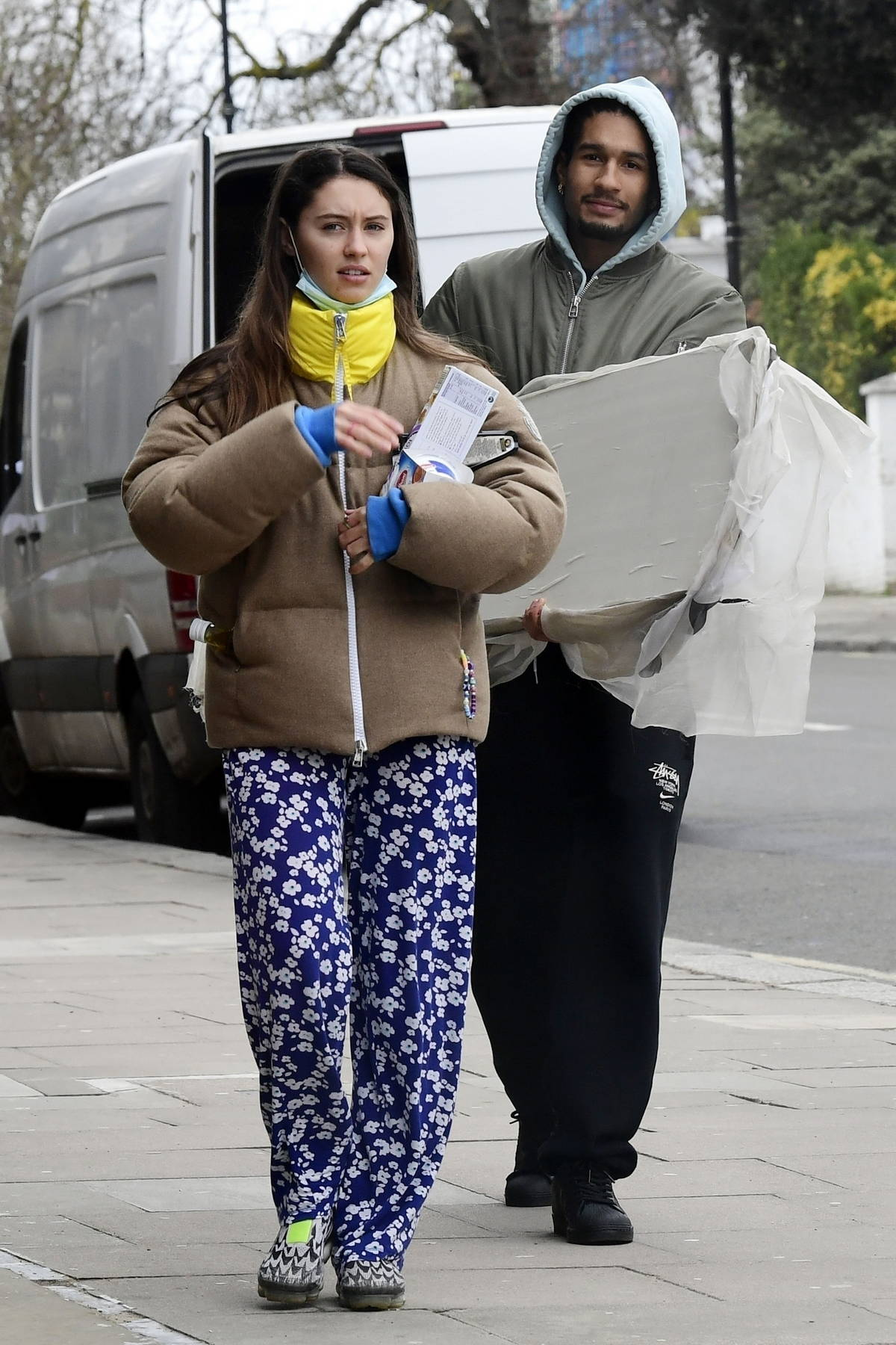 Iris Law keeps it casual as she steps out with boyfriend Jyrrel Roberts to grab a few items in London, UK