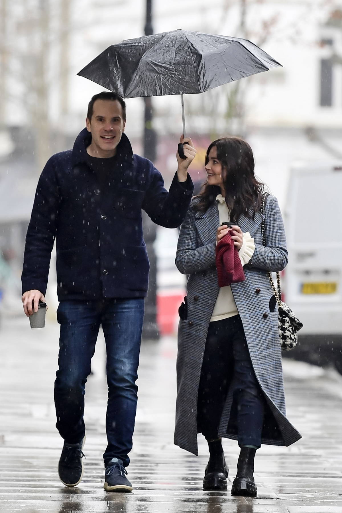 Jenna Coleman and Fabien Enjalric step out for walk on a rainy day in London, UK