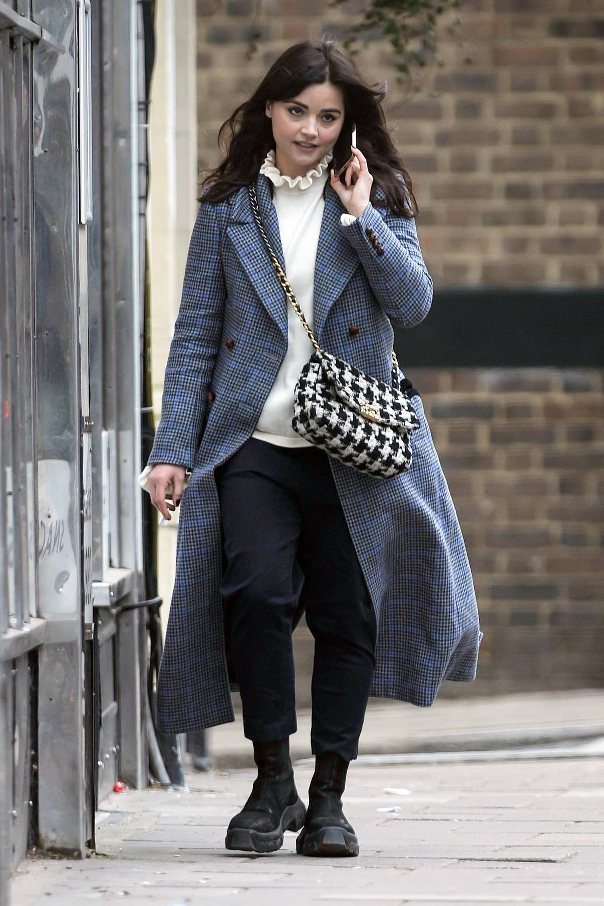 Jenna Coleman seen chatting on her phone while out for walk in London, UK
