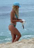 Joanna Borov seen wearing a bikini while cleaning the beach in Dominican Republic