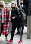 JoJo Siwa joined by her mom as they arrive to catch a flight out of Vancouver, Canada