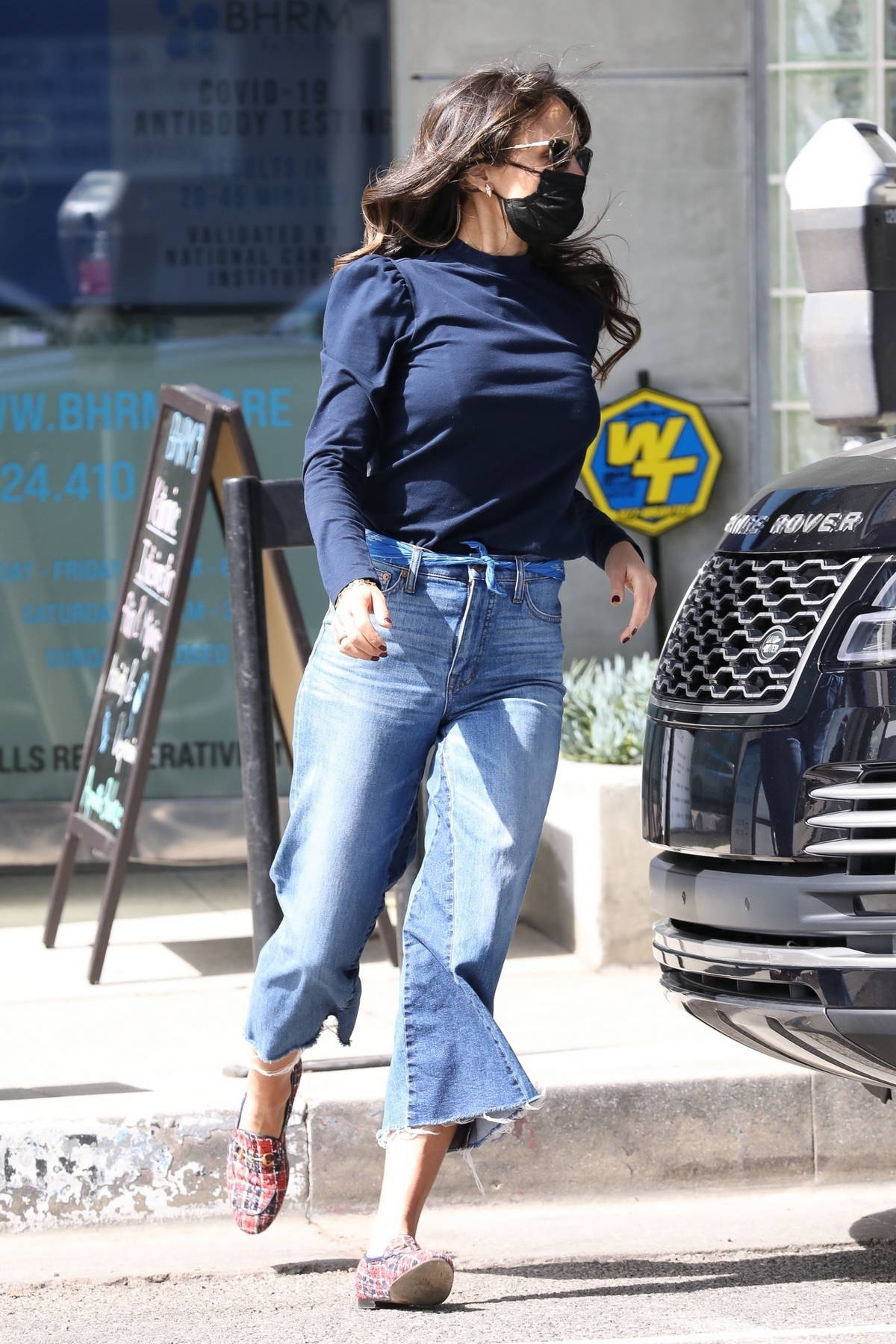 Jordana Brewster wears a blue top and flared jeans while running errands around town in Los Angeles