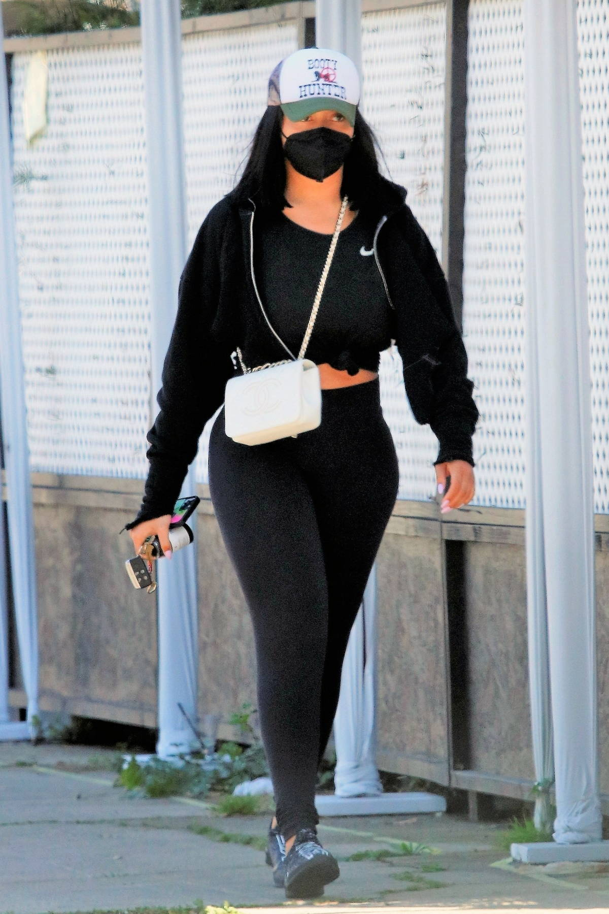 Jordyn Woods flaunts her curves in all-black athleisure while leaving a spa in Los Angeles