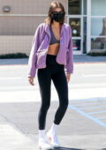 Kaia Gerber flashes her midriff in crop top and leggings while stopping for a post-workout juice in West Hollywood, California