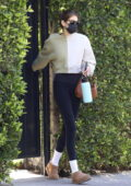 Kaia Gerber leaves her morning workout sporting a two-toned sweatshirt with black leggings in West Hollywood, California