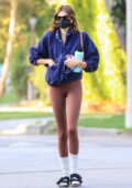 Kaia Gerber showcases her slender frame in brown leggings and blue jacket while attending her Pilates class in Los Angeles
