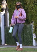 Kaia Gerber sports a purple teddy jacket and dark grey leggings while attending a Pilates class in West Hollywood, California