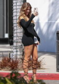 Kara Del Toro flaunts her legs in a black minidress while posing for photos on Rodeo Drive in Beverly Hills, California
