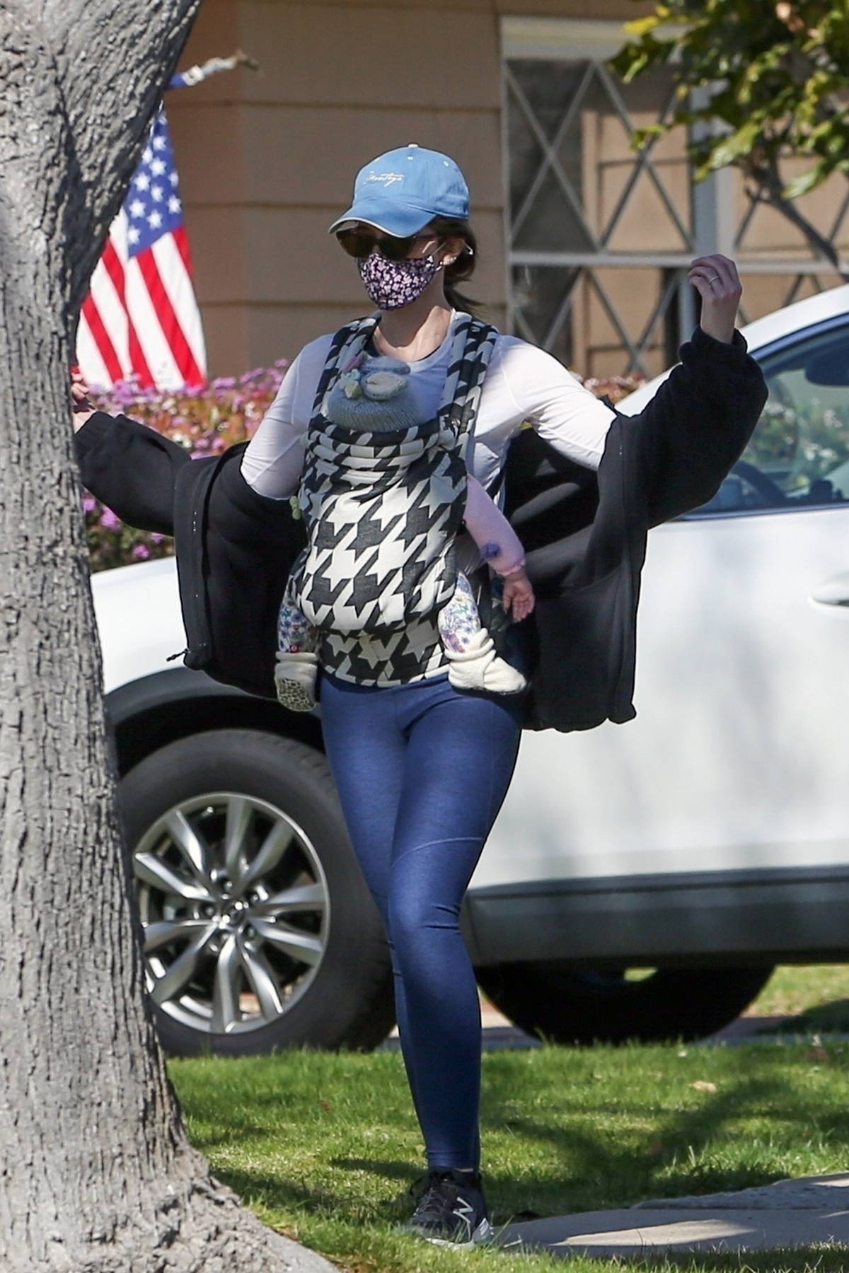 Katherine Schwarzenegger steps out for a stroll with her baby daughter strapped to her chest in Santa Monica, California