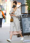 Katie Holmes looks cool in a boho-chic dress paired with white sneakers as she leaves Cafe Belle in New York City