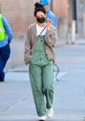 Katie Holmes seen wearing green overalls as she chats on her phone while out for a stroll in New York City