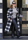Kelly Brook looks great in a checkered coat and tight leather pants as she arrives for her show on Heart radio in London, UK