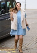 Kelly Brook looks pretty in a blue dress, fur jacket, and knee-high boots while arriving at the Global Radio Studios in London, UK