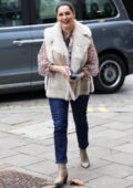 Kelly Brook looks stylish in a fur jacket over a frilly blouse and jeans as she arrives at Heart radio in London, UK