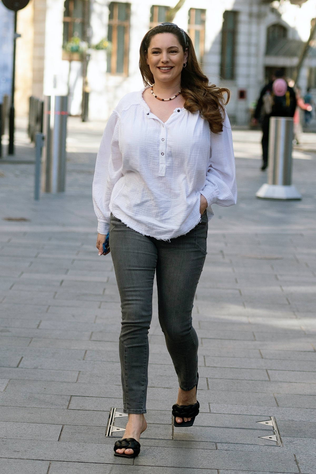 Kelly Brook looks summer ready in a white blouse and skinny jeans while arriving at the Global Radio studios in London, UK