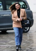 Kelly Brook makes a fashionable appearance at Heart radio in a beige blazer and blue jeans in London, UK