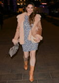Kelly Brook makes a leggy appearance in floral print minidress at Heart Radio in London, UK