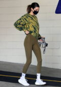 Kendall Jenner displays her model figure in green leggings while leaving a workout in Beverly Hills, California