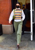 Kendall Jenner rocks a white shirt with a multi-color striped sweater vest as she heads out for lunch in New York City
