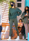 Kendall Jenner shows off her slender figure in leggings while out for coffee with friends in West Hollywood, California