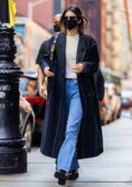 Kendall Jenner steps out looking stylish in a full-length coat over a white top and blue jeans in New York City