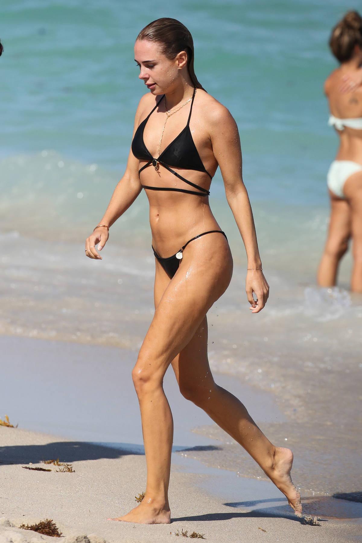 Kimberley Garner looks incredible in a black bikini as she hits the beach in Miami, Florida