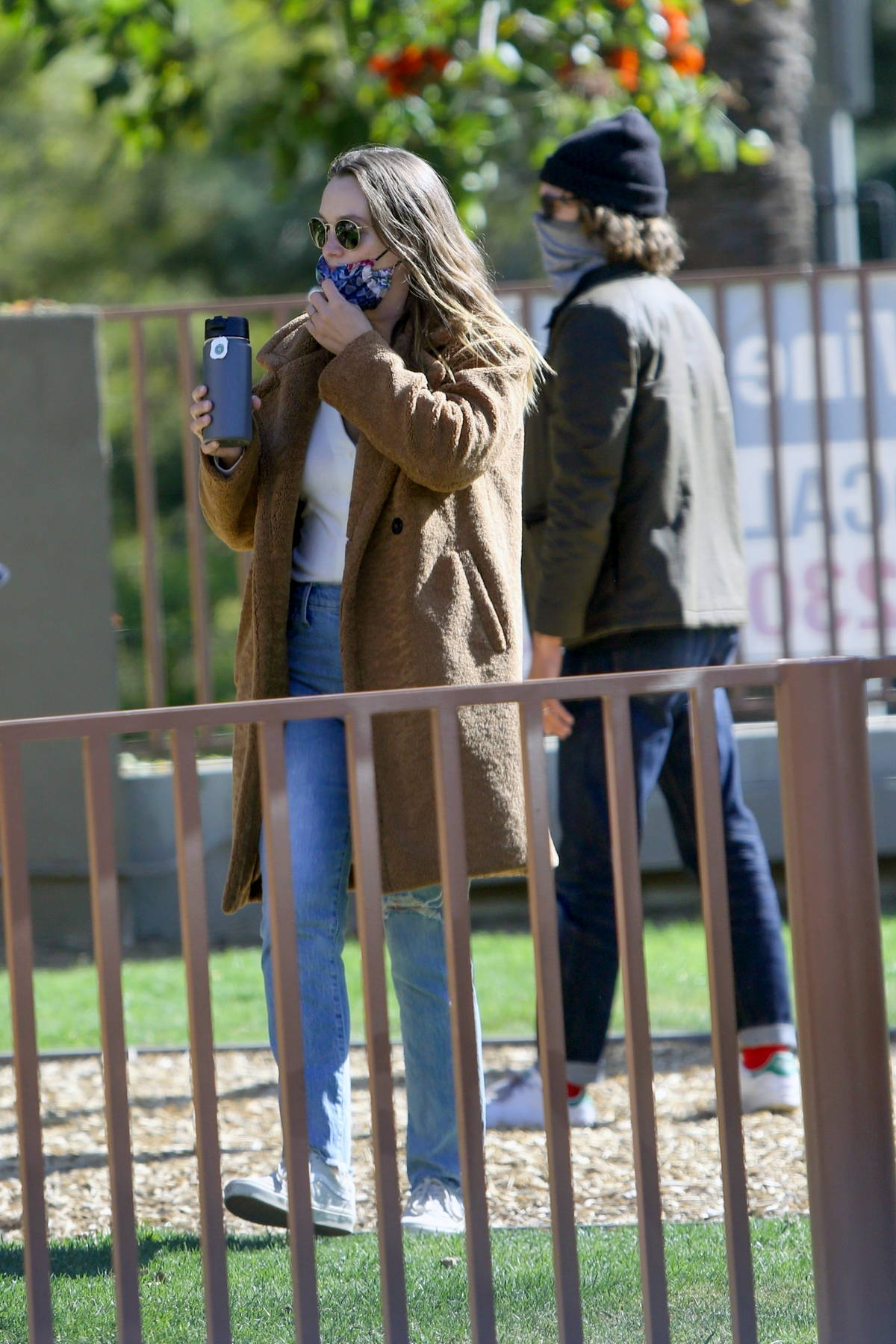 Leighton Meester and Adam Brody take their daughter Arlo to a local park in Los Angeles
