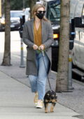Lili Reinhart matches a cute mustard crop top to her yellow Converse as she takes dog out for a walk in Vancouver, Canada