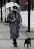 Lili Reinhart stays warm in a grey coat as steps out to walk her dog in Vancouver, Canada