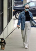 Lili Reinhart wears a denim jacket for a dog walk in Vancouver, Canada