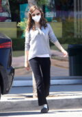 Lily Collins stops to pick up dog food before dropping off her dog in West Hollywood, California