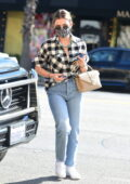 Lucy Hale dons a checkered shirt and jeans while stopping by a LaserAway clinic in Los Angeles