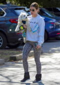 Lucy Hale dons 'FRIENDS' sweatshirt with animal print leggings while out hiking with her dog in Los Angeles