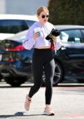 Lucy Hale looks radiant as she leaves the gym wearing a cropped hoodie and leggings in Los Angeles