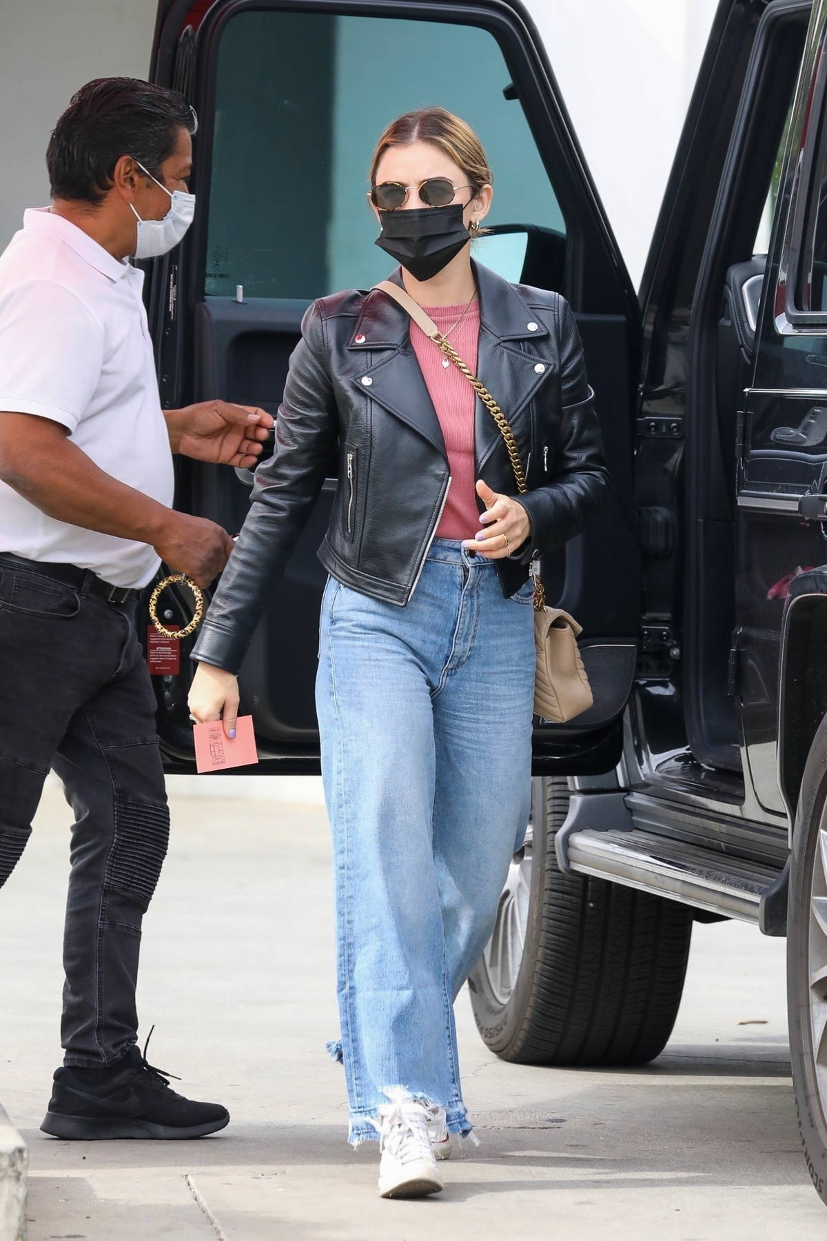 Lucy Hale rocks a leather jacket with a pink top and jeans while out shopping at a clothing store in Los Angeles