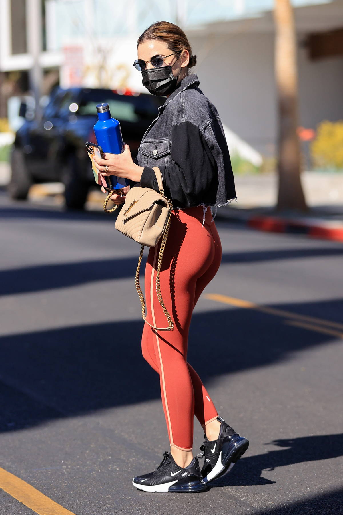Lucy Hale sports red leggings and a crop top with denim jacket as she leaves a spa in West Hollywood, California